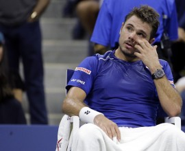 Stan Wawrinka, of Switzerland, takes a break between games during a semifinal match against Roger Federer, of Switzerland, at the U.S. Open tennis tournament, Friday, Sept. 11, 2015, in New York. (AP Photo/David Goldman)